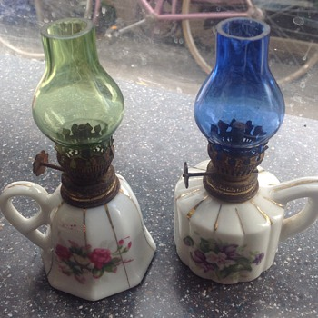 Two charming mini oil lamps.