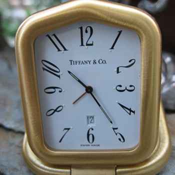 Tiffany is timeless.... so keep time by Tiffany.  My mini travel/desktop man's clock.  - Clocks