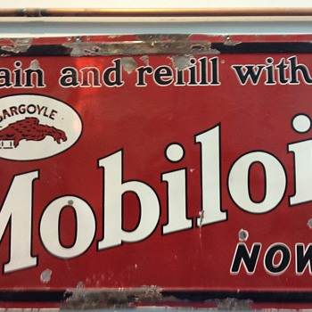 Mobile oil gargoyle sign