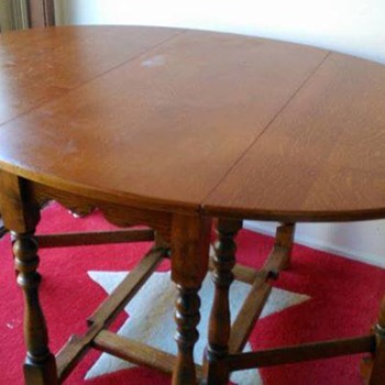 Early 1919 Oval drop leaf table-stamped