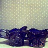 Dark blue, believe carnival glass, diamond cut on top, etc. creamer & sugar bowl. Can't find name to save my life. Someone HELP