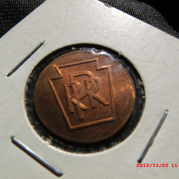 1976 Lincoln cent with the Pennsylvania Railroad logo. PRR