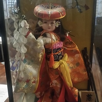 japaneese doll in glass case