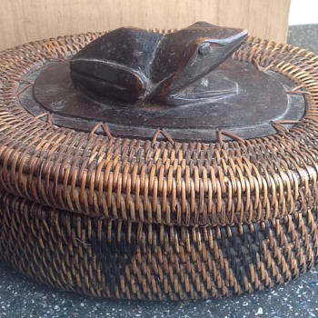 Indonesian wicker basket with wooden frog handle.