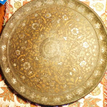 Metal Plate 11 1/2 inch Diameter, weighs 3.1 lb. very tarnished, non-magnetic, never seen one like this, need help