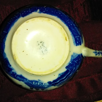 Blue and white tea cup Possible Flow Blue
