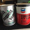 Two vitnage oil cans