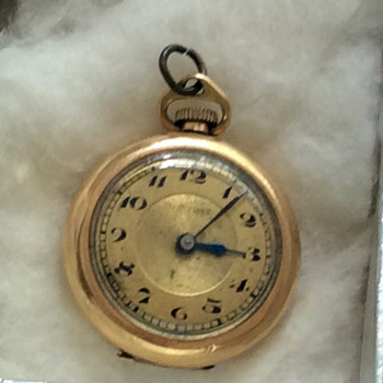 SMALL GOLD POCKET WATCH