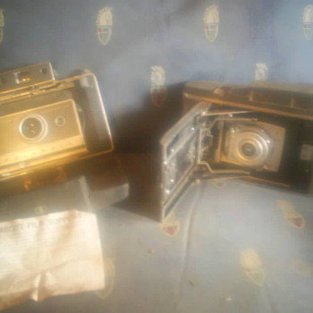 Old Polaroid and Kodak cameras