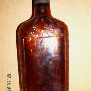 1940's Lord Calvert Canadian Whiskey Brown Glass Embossed 'Men of Distinction' Flask - Bottles