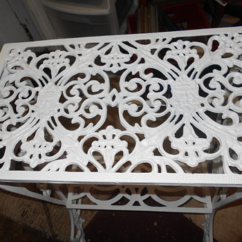 Cast iron plant stand .