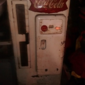 Antique Coca-Cola machine, rough shape but still works.