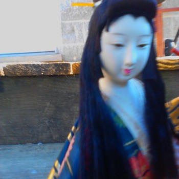 Long haired flute player with Olive Oyl hairstyle (continued) - Dolls