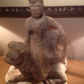 Marble Buddha sitting on lion - Asian