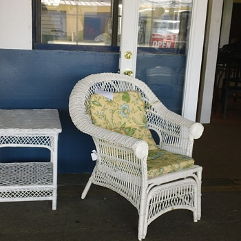 White wicker lounge chair.