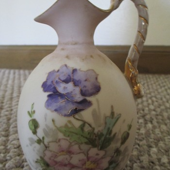 A pretty little porclean pitcher hand painted - China and Dinnerware