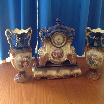Clock and vases would like to know how old it is