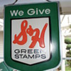 Lighted S&H Green Stamps sign