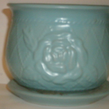 I belive this is a McCoy although, I have no genral idea, do you? - Art Pottery