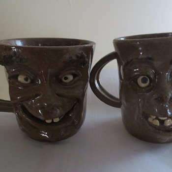 A set of wonderful mugs graniteware creamers..and a mouse trap