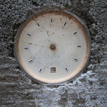 Watch Embedded in Concrete -- Time Capsule?
