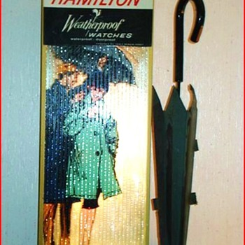 "Lighted, motorized vintage ""Hamilton Weatherproof Watch"". - Signs"