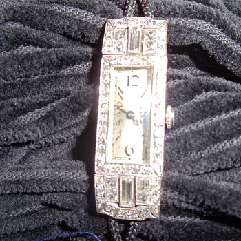 Made in 1805, Platinum band with 17 Diamonds.