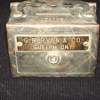 "Promotional Advertising Steel Bank""G.B RYAN & Co,GUELPH,ONT"" - Coin Operated"