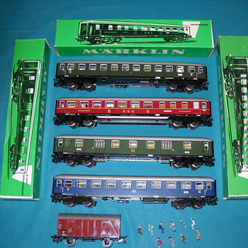 Marklin train cars, track with boxes.