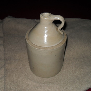 Vintage white whiskey jug