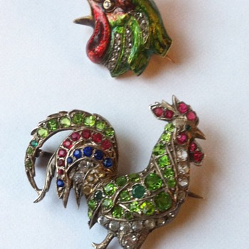 Rooster brooches.