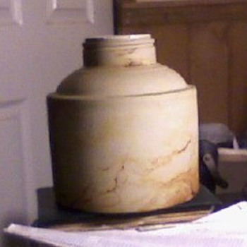 I know that it is stoneware... no evidence of a lable or markings of any kind as well as a non threded neck....