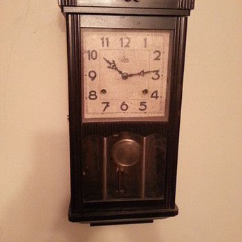 T.S.K. chiming wall clock, double time pendulum swing