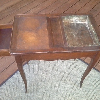 small table with copper and leather on top