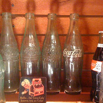 Small collection of old Coke Bottles