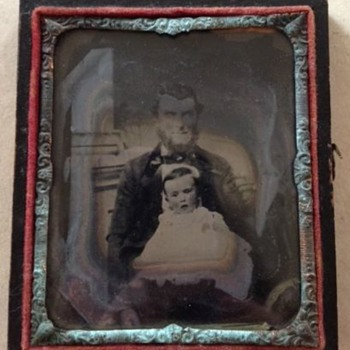 Ca 1860 Father and baby ambrotype in discolored copper frame