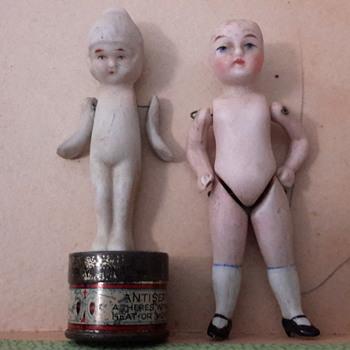 Antique German bisque mignonette and Japanese Cupie? frozen charlotte?