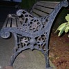 Outdoor wooden and wrought iron bench
