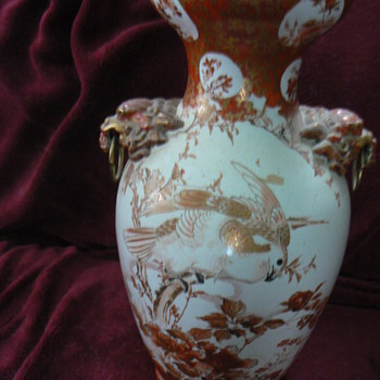 Medium sized oriental vase with foo dog/dragon handles