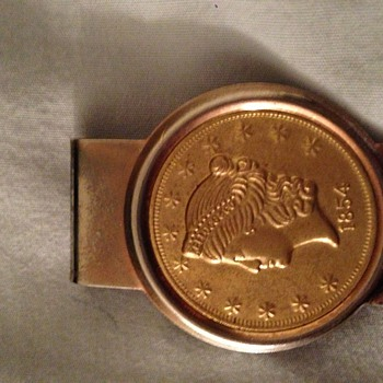 1854 money clip  a coin ?