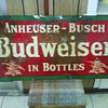 A Budweiser tin sign