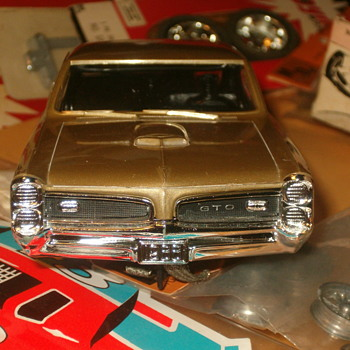 1/24TH SCALE M.P.C. 66 PONTIAC GTO IN GOLD METALLIC