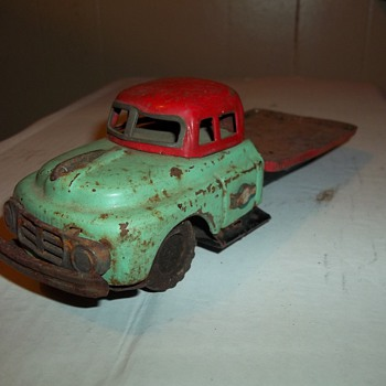VINTAGE PRESSED TIN FRICTION DRIVE TRUCK