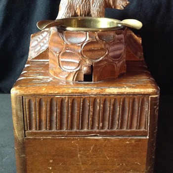 Swiss made music box, bear and ashtray.