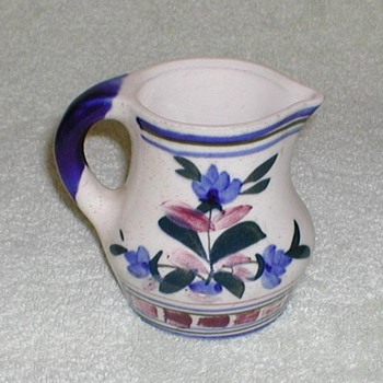 Stoneware pitcher with floral design