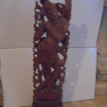 Sandalwood statue  -is it  Hindhu ? - Asian