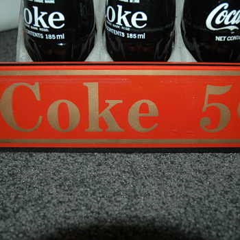 Coke glass sign