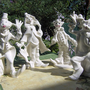 Porcelain Clowns trimed in Gold - Pottery