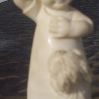 Carved Ivory figure, signed?