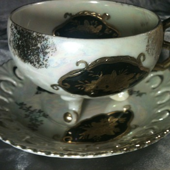 Gold and black Rainbow glass china cup and saucer 